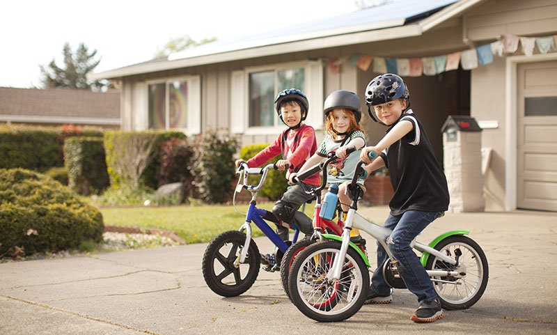 Kids riding a bike family protection home and contents insurance