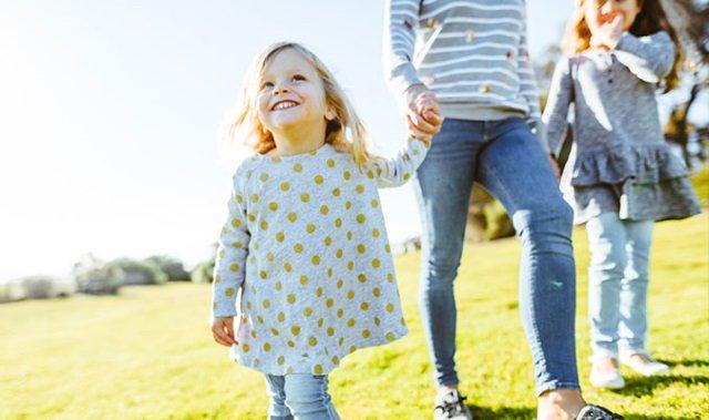 Child With Family Enjoying Health Insurance Rebate