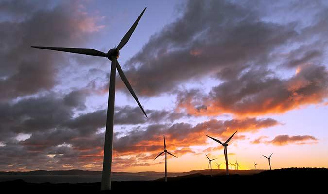 Solar power windmills sunset
