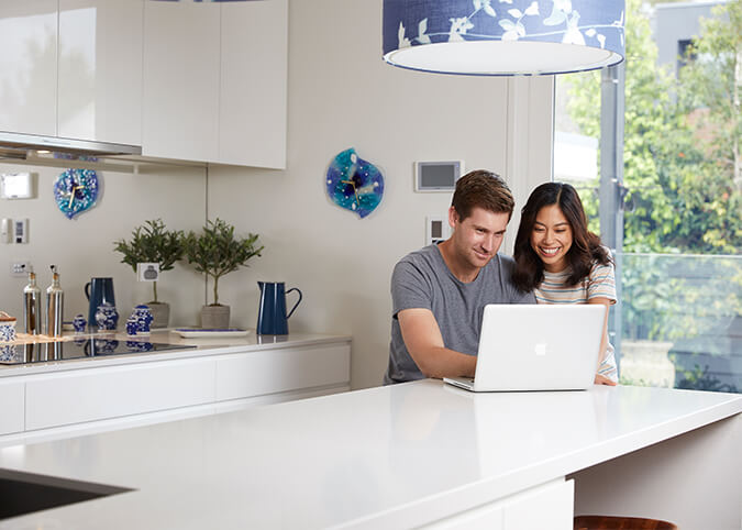 Young couple on laptop in kitchen
