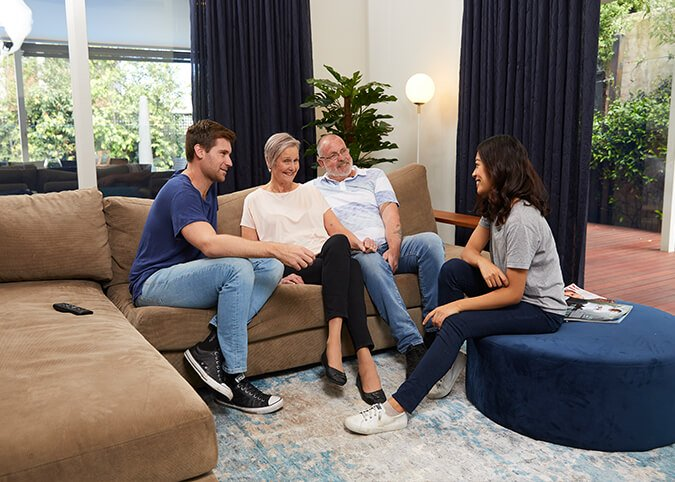 Family sitting together in living room