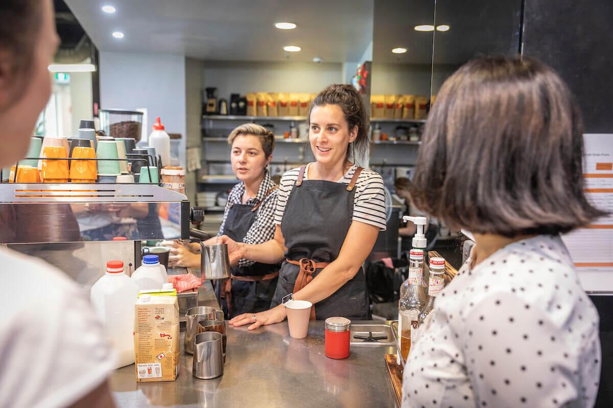 Barista making coffee in an Australian café
