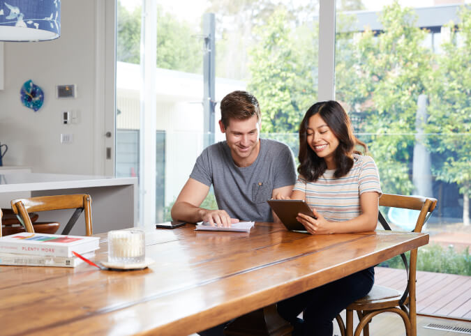 Couple reviewing home loans rates online