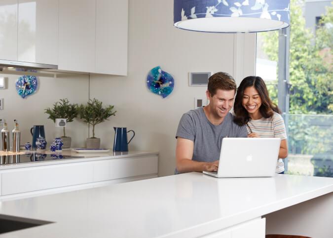 Couple using home broadband on laptop