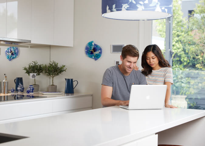 Couple using home broadband on laptop