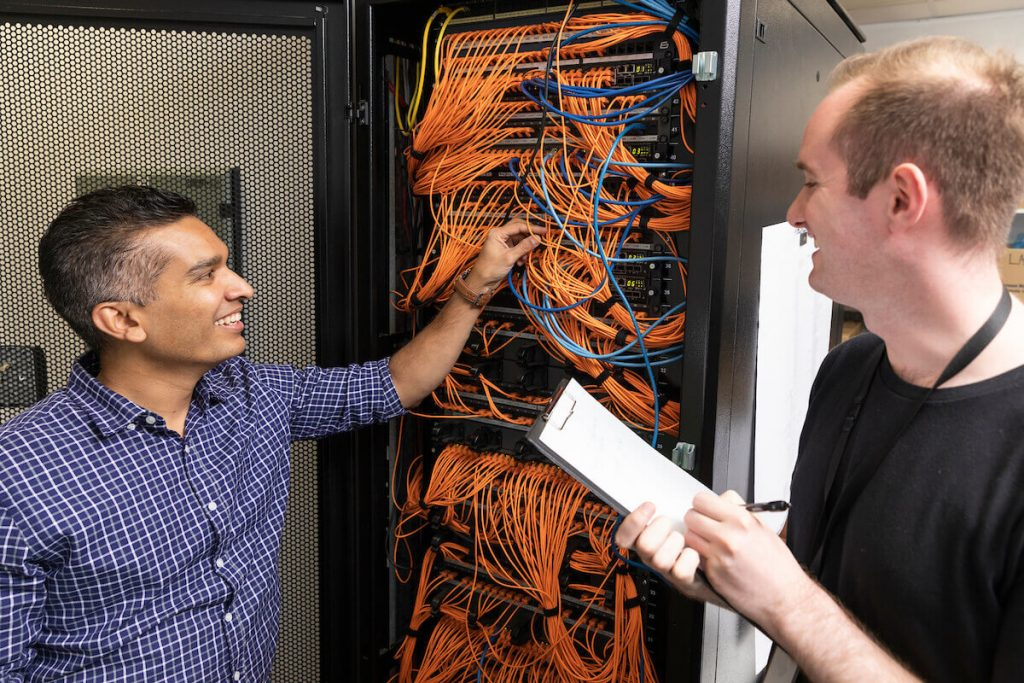 Two IT professional inspecting cyber infrastructure