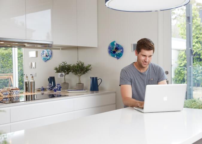 Man on laptop using internet at home