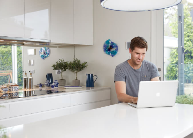 Man on laptop using internet at home