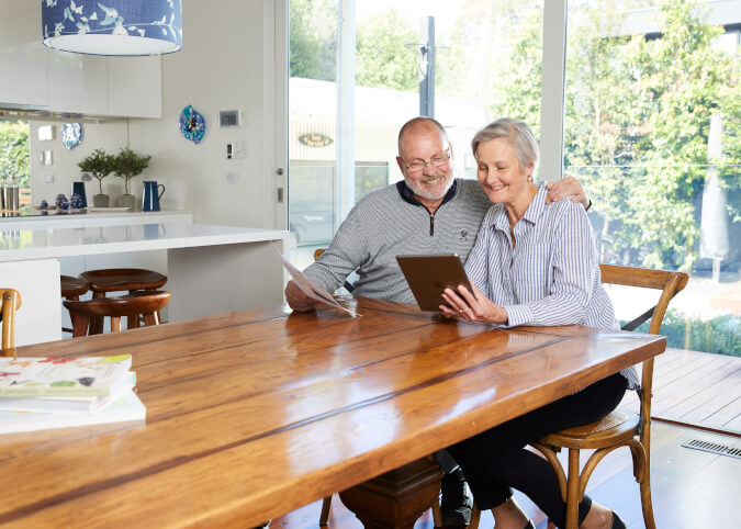 Mature couple comparing energy plans in home