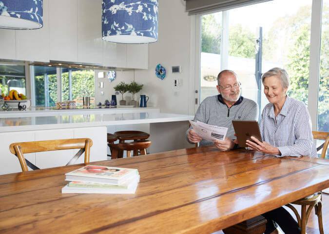 Mature couple comparing home loans online