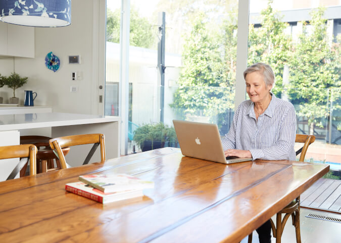 Mature woman reviewing home loans