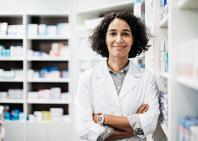 pharmacist in white coat smiling