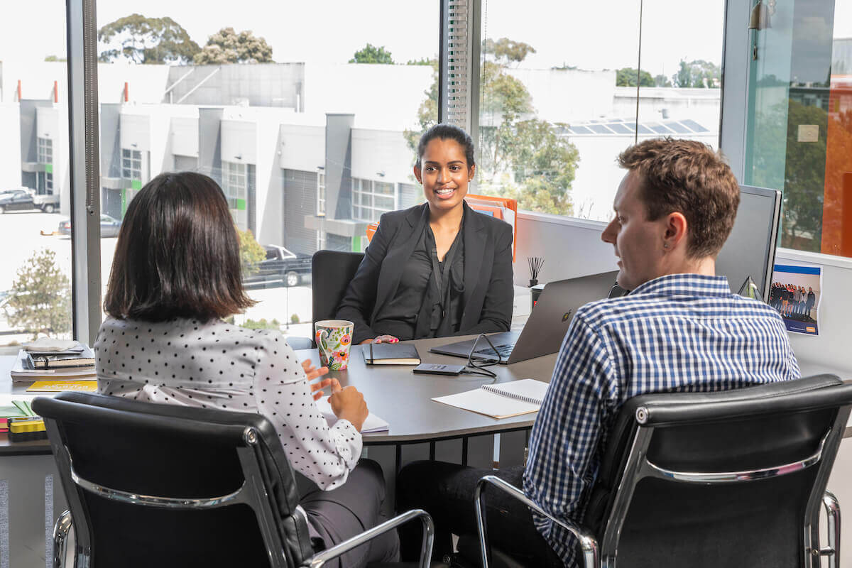 Tax accountant consulting with married couple in office