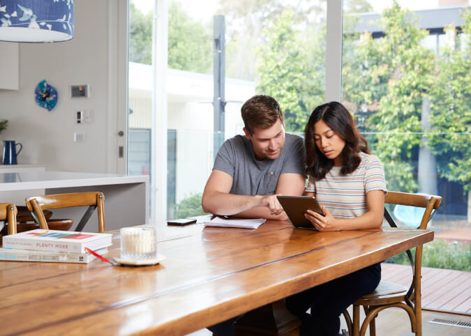 Young couple researching lenders insurance online