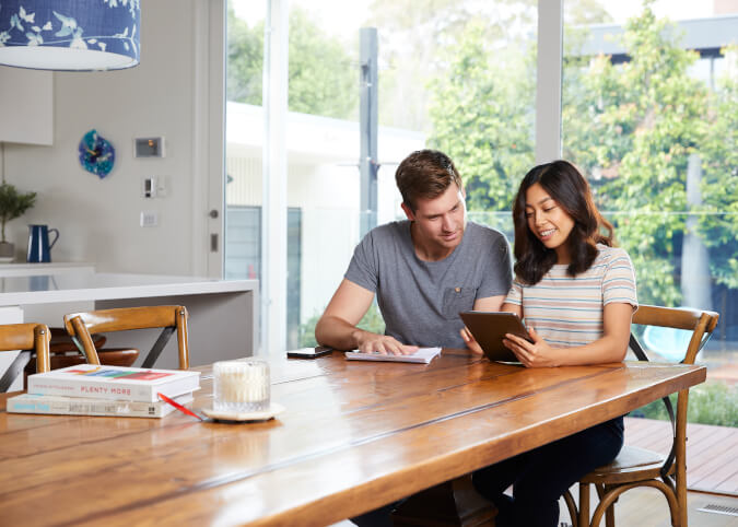 Young couple discussing different energy plans
