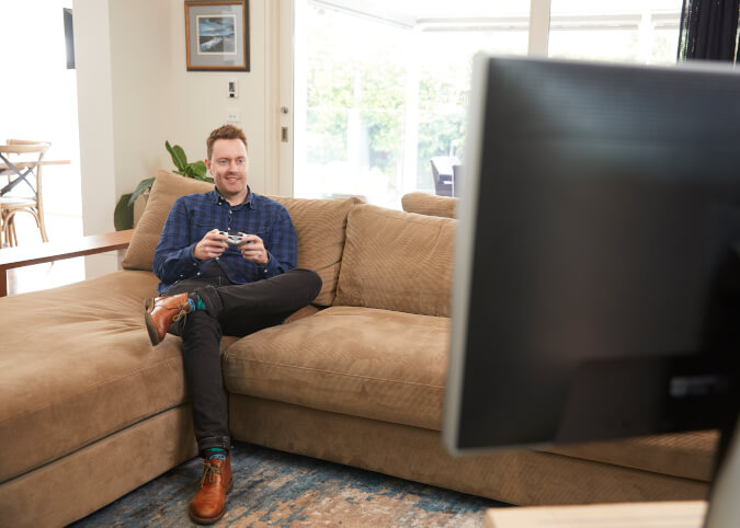 Young man streaming online game at home