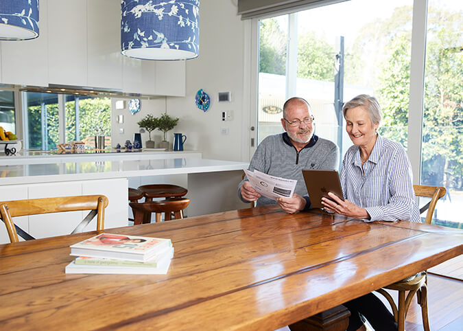 mature couple researching insurance online