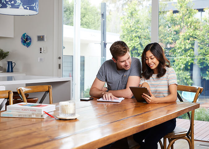 Young couple comparing energy plans at home